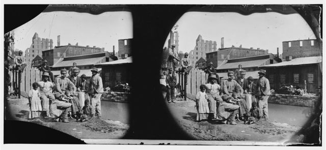 """Richmond, Virginia. Group of Negroes (""""Freedmen"""") by canal"""