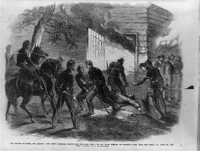 The killing of Booth, the assassin - the dying murderer drawn from the barn where he head taken refuge, on Garrett's farm, near Port Royal, Va., April 26, 1865