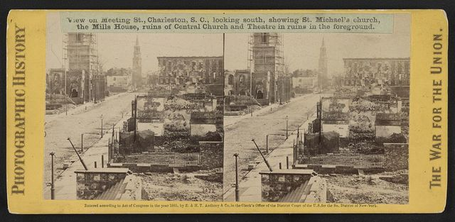 View on Meeting St., Charleston, S.C., looking south, showing St. Michael's church, the Mills House, ruins of Central Church and Theatre in ruins in the foreground