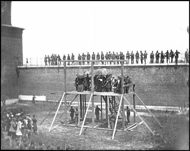 [Washington, D.C. Gen. John F. Hartranft reading the death warrant to the conspirators on the scaffold]