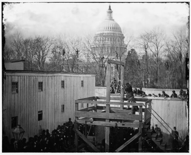 [Washington, D.C. Soldier springing the trap; men in trees and Capitol dome beyond]
