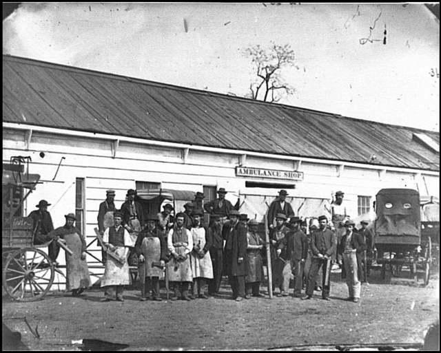 [Washington, D.C. Workmen in front of the Ambulance Shop]
