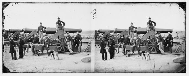 Washington, District of Columbia. Officers and men, 3d Regiment Massachusetts Heavy Artillery by Columbiad guns, Fort Totten