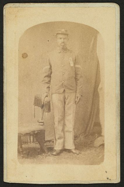 [Full length portrait of an African-American man, possibly a Buffalo soldier] / Mosser & Snell, Traveling Photographic Art Gallery, Cantonment, Ind. Terr.