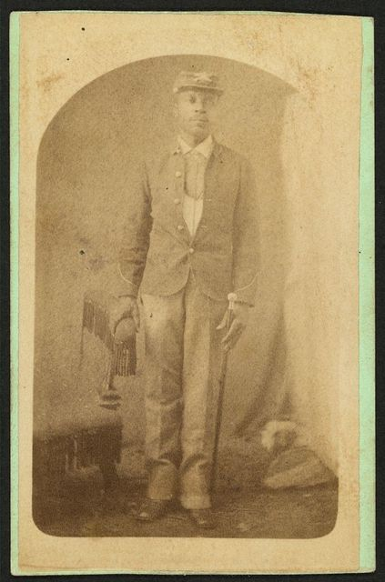 [Full-length portrait of an African-American man, possibly a Buffalo soldier] / Mosser & Snell, Traveling Photographic Art Gallery, Cantonment, Ind. Terr.