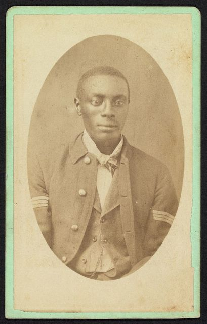 [Half-length portrait of an African American man, possibly a Buffalo soldier] / Mosser & Snell, Traveling Photographic Art Gallery, Cantonment, Ind. Terr.