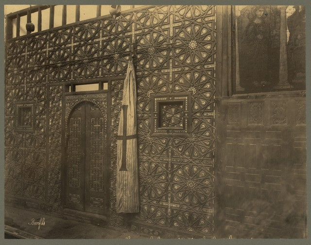 [Carved wood wall and doors, possibly an iconostasis, in the Coptic Church of Saint Barbara, Cairo]