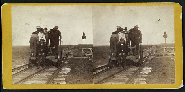 Section men at Salina, Kansas (The extreme distance is five miles off), 447 miles west of St. Louis, Mo.