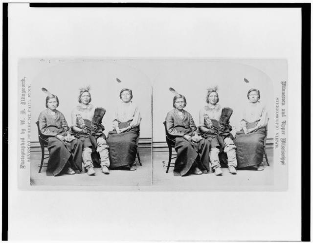 [Three Winnebago men, full-length portraits, seated, facing front] / photograph by W.H. Illingworth.