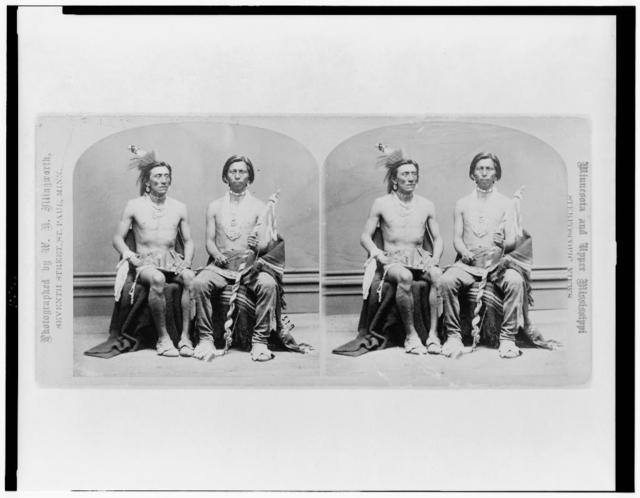 [Two Winnebago men, full-length portraits, seated] / photographed by W.H. Illingworth.