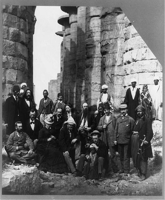 [Ulysses S. Grant, full-length portrait, seated, facing right, with others at pyramids, Egypt]