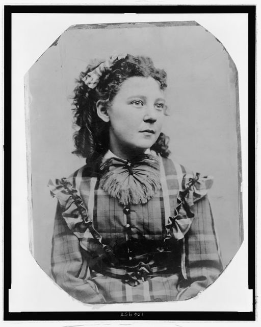 [Unidentified girl in a plaid dress]
