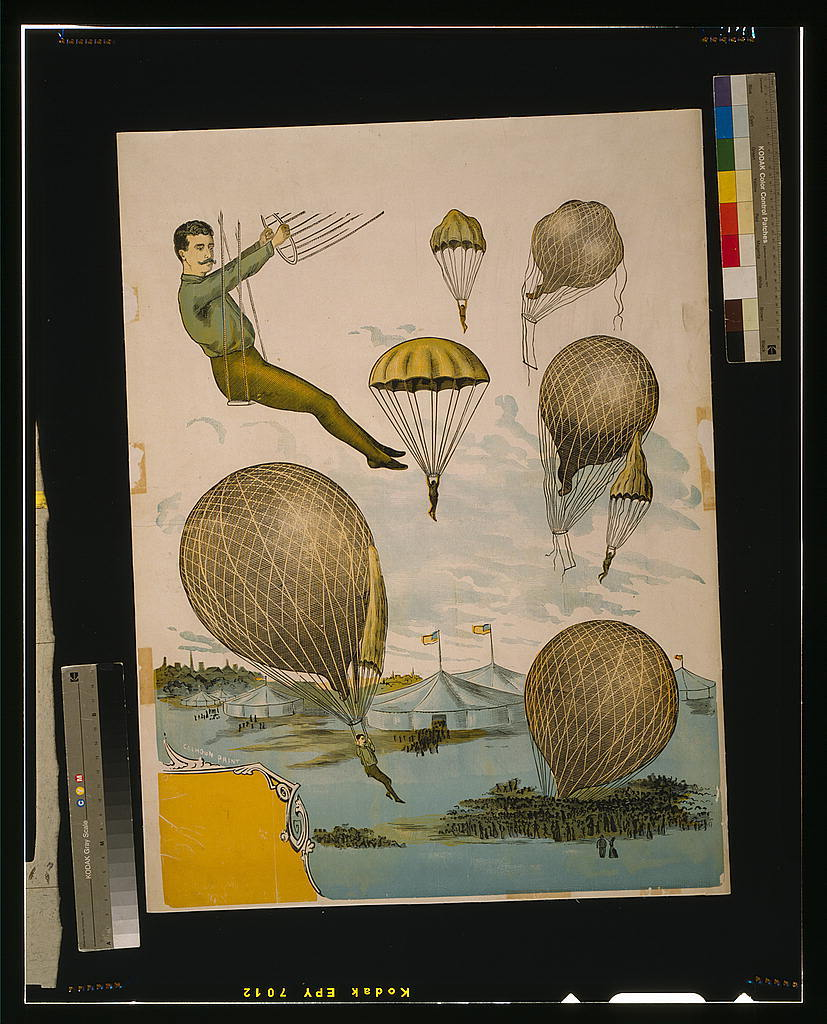 [Aerial balloon performance with tents and audience below]