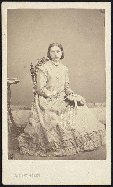 [Antoinette Margot, full-length studio portrait, seated, facing front] / A. Bertholet.