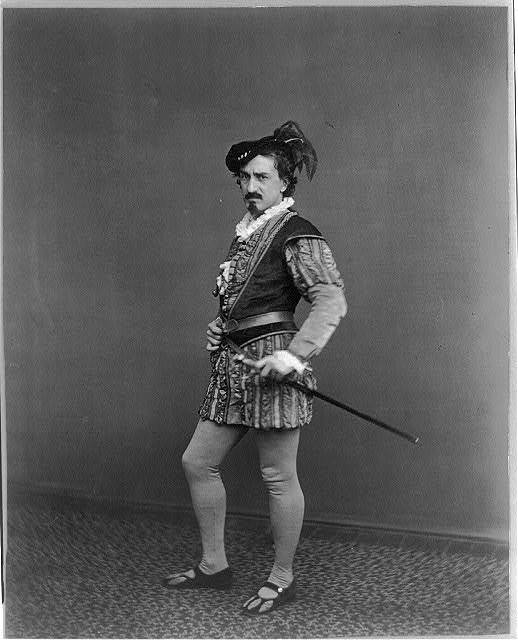 [Edwin Booth as Iago, full-length portrait, standing, facing left]
