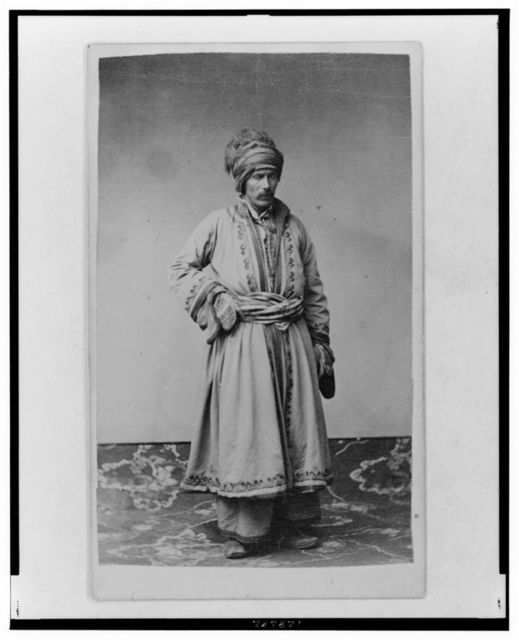 [George Kennan, full-length portrait in traditional costume of unidentified Russian ethnic group, facing slightly right]