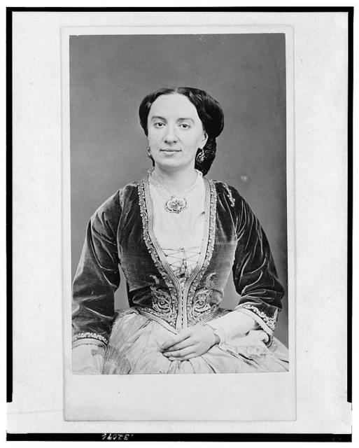 [Half-length portrait of a woman, seated, facing front]