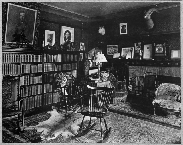 [Interior of Sagamore Hill with bookcases and fireplace]