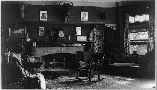 [Interior of Sagamore Hill with chairs before a fireplace]