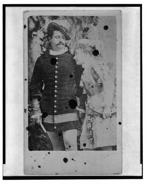 [Maud Granger and John Lawrence Toole, actors, in costume for play As You Like It, three-quarter length portrait]