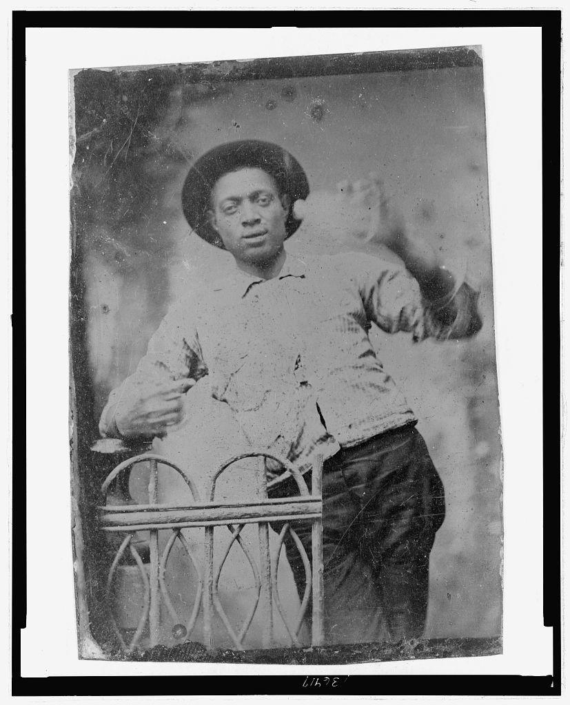[Three-quarter length portrait of African American man, standing]