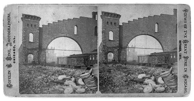 [Ruins at Union Depot, after the great fire of Oct. 1871, Chicago, showing wall and railroad cars]