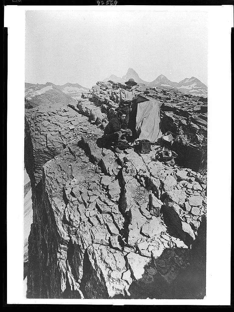 [William Henry Jackson and another man with photographic equipment on mountain near Yellowstone Park, Wyoming, 1871-1878]