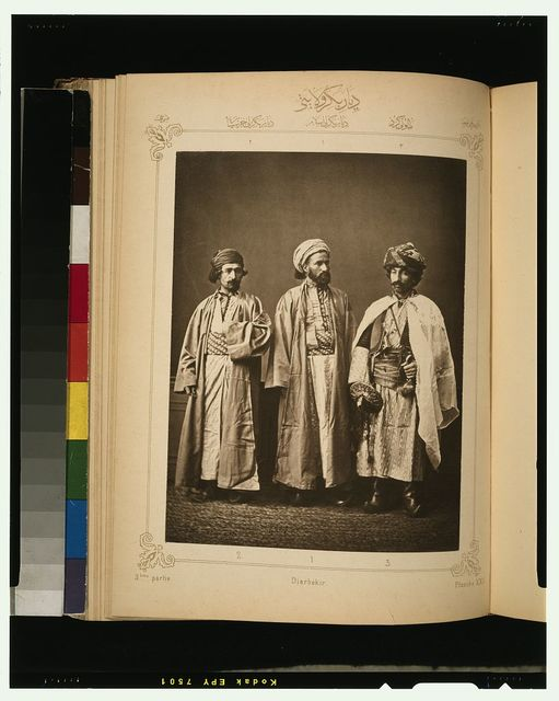 [Studio portrait of models wearing traditional clothing from the province of Diarbèkir (Diyarbakır), Ottoman Empire]