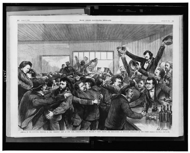 """Arrival of the surviving prisoners of the """"Virginius"""" crew at New York - demonstrations of welcome by their friends and sympathizers at Trujillo's restaurant in Pine Street / sketched by Matt Morgan."""