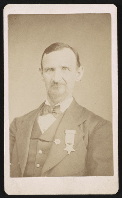 [Nicholas G. Wilson, Civil War veteran, with Grand Army of the Republic medal]