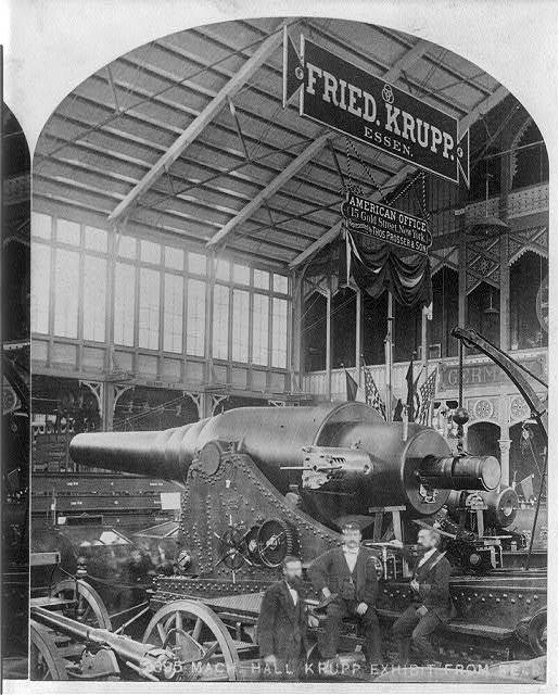 "[Philadelphia Centennial Exhibition, 1876: ""Mach. Hall, Krupp Exhibit from rear (showing large wheeled cannon)""]"