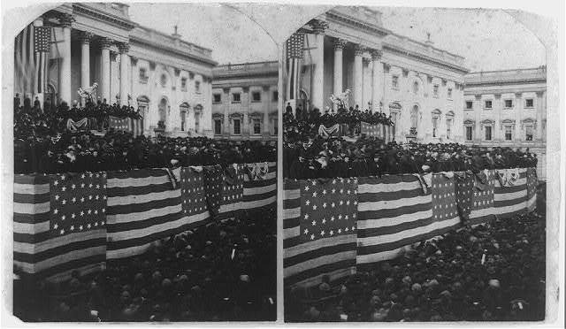 [Chief Justice Morrison R. Waite administering the oath of office to Rutherford B. Hayes on a flag-draped inaugural stand on the east portico of the U.S. Capitol]