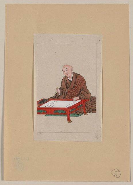 [An old man, possibly a monk or scholar, seated a low table writing on scroll with brush]