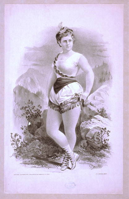 [Woman in burlesque costume in front of rocky outcrops]