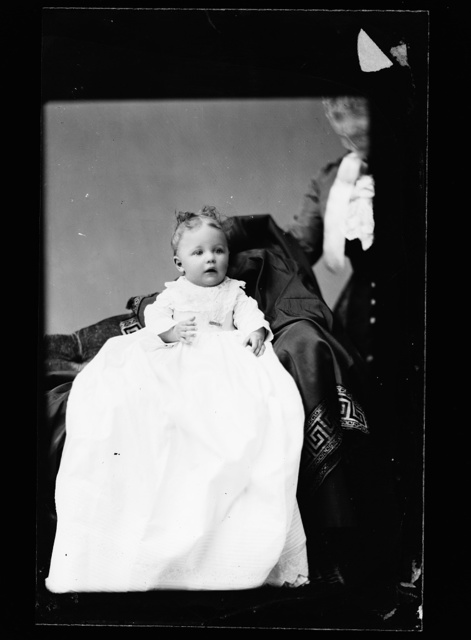 [Baby in christening gown]