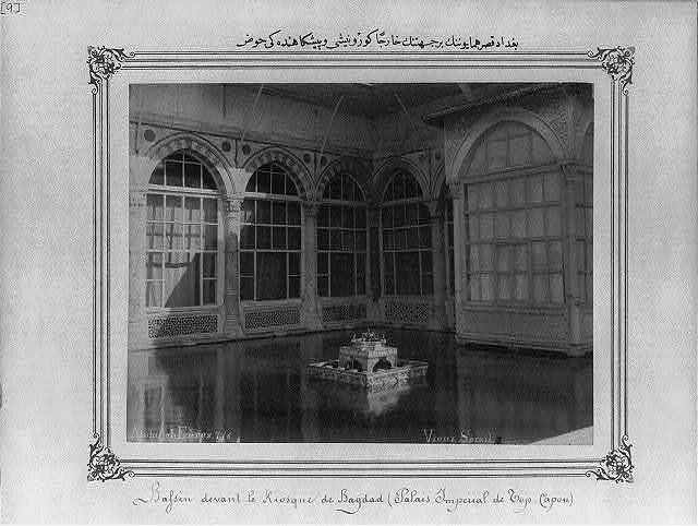 [Exterior view of the Imperial Baghdad Pavilion and the pond in front of it] / Abdullah Frères.