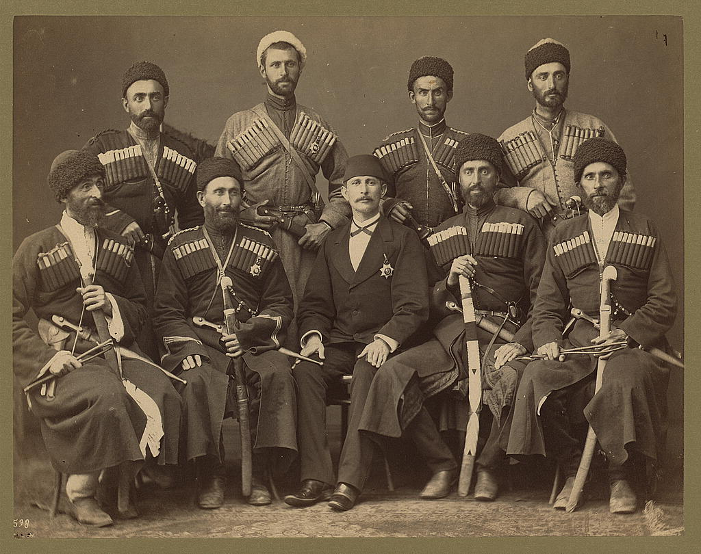 [Group portrait of eight Circassian men in uniform, with another man, possibly an Ottoman official]