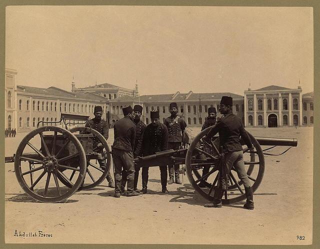 [Lancers on horseback, in field in front of barracks(?)]