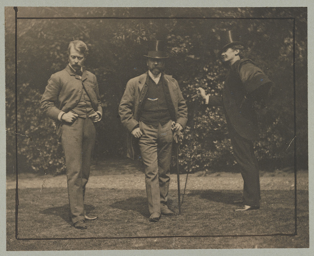 [Mortimer Menpes, William M. Chase, and James McNeill Whistler standing together outdoors]