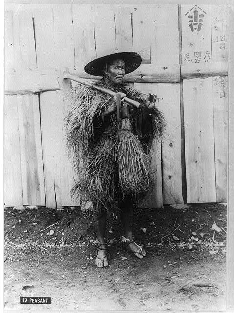 [Peasant wearing raincoat of straw, Japan, ca. 188-]