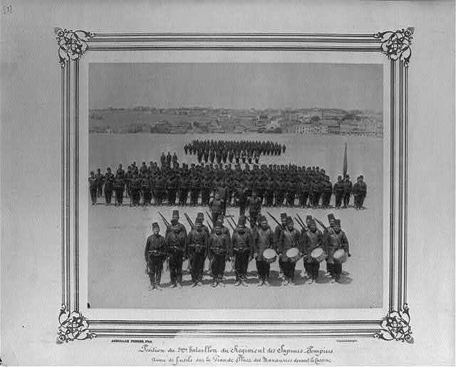 [Position of the Second Battalion of the Fire Brigade, armed with guns on the parade ground in front of the barracks] / Abdullah Frères, Phot., Constantinople.