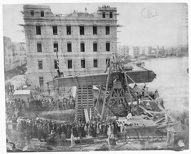 [The 'Obelisk' horizontal position...with Alexandria [Egypt], showing a portion of the city waterfront. The crated obelisk ready for shipment from Egypt to New York City]
