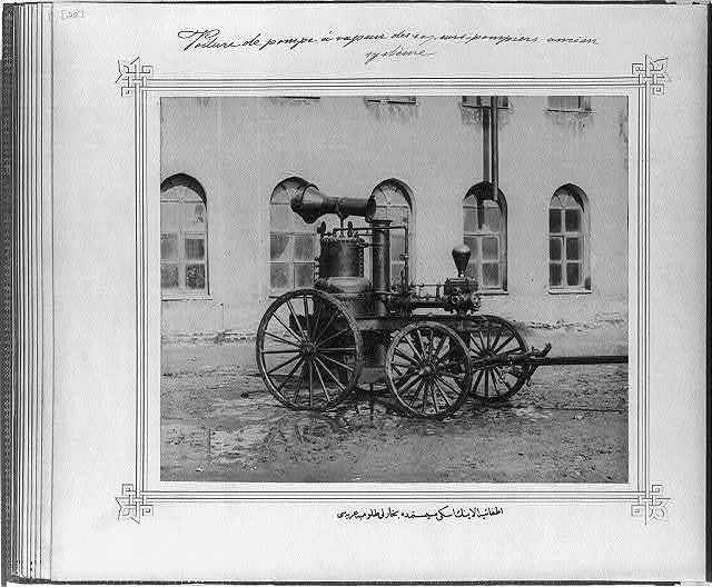[The old-fashioned steam fire engine of the Fire Brigade]