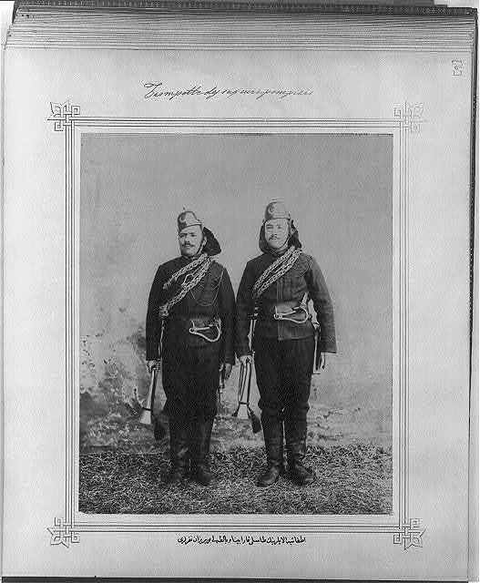 [The soldiers of the Fire Brigade with bugles, axes, carbines, and helmets]
