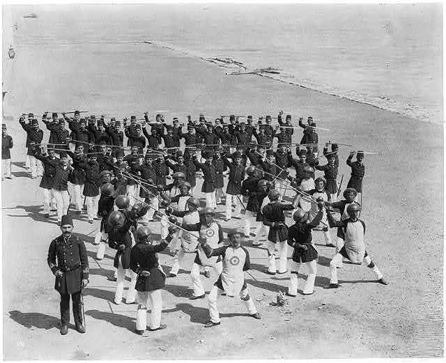 [The students of the Imperial Naval Academy. The exercise with maces] / Constantinople, Abdullah Frères.