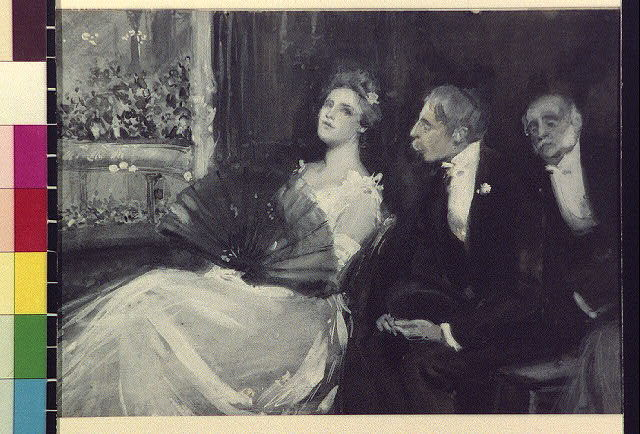 [Two men and a woman in a theater balcony]