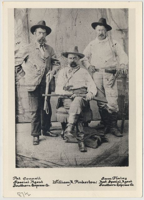 [William A. Pinkerton with railroad special agents Pat Connell (left) and Sam Finley (right), full-length portrait]