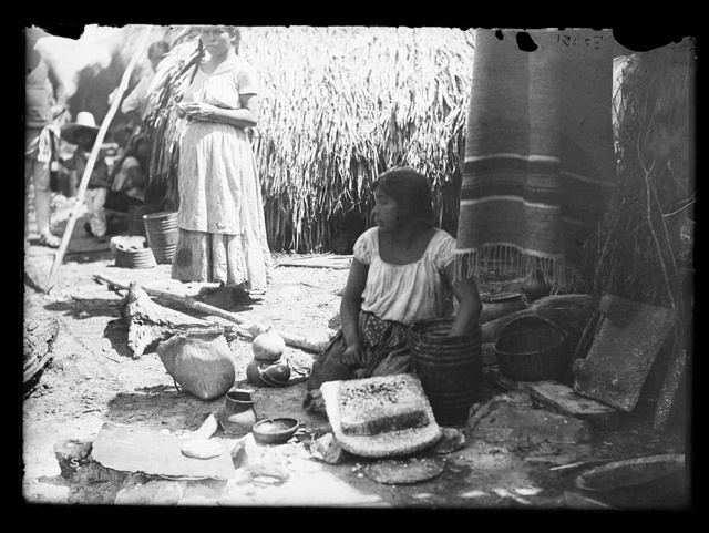 [Woman with pottery at market, probably Mexico]
