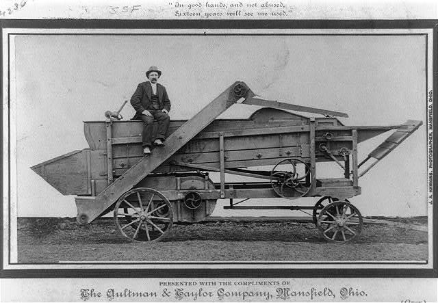 [Man seated on Aultman-Taylor threshing machine] / J.A. Hawkins, photographer.