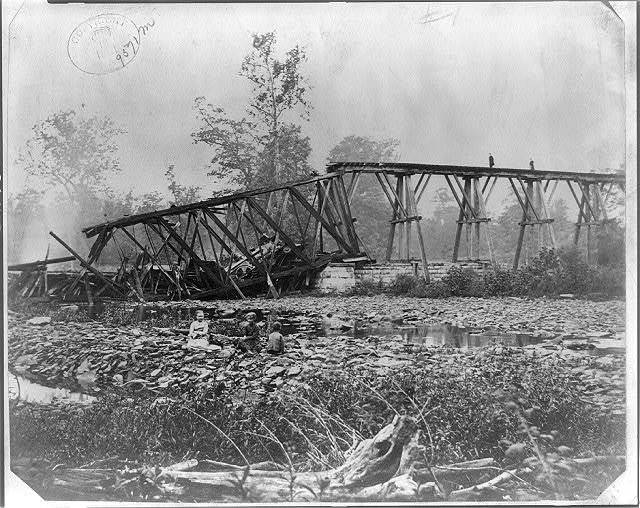 Photographic view of the wreck of the bridge and train of cars crossing Big Walnut near Sunbury, Ohio